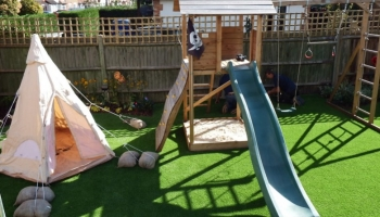 Milestone contributes landscaping supplies to garden for Woking toddler